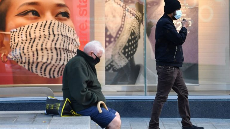 Pedestrians are seen wearing masks in Liverpool