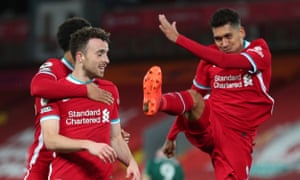 Diego Jota celebrates with Roberto Firmino and Trent Alexander-Arnold after beating Liverpool's winner.