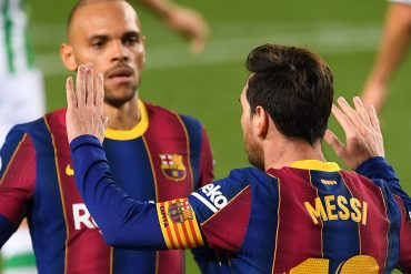 Lionel Messi is congratulated after netting against Real Betis