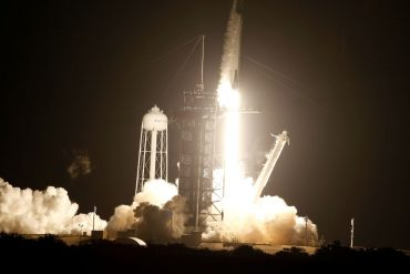 A SpaceX Falcon 9 rocket, with the Crew Dragon capsule, is launched