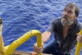 After 24 hours in the waters off Florida, he found the man clinging to an inverted ship.