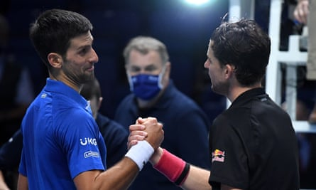 Novak Djokovic congratulates Dominic Evil on the end of their three-hour confrontation
