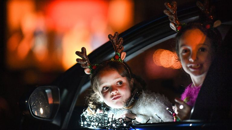 Perth, Scotland - December 10: Two young women look out of a car window as students, parents and guardians attend the filming of the Gilgorston Girls' School Drive on December 10, 2020 in Perth, Scotland.  The school is releasing a Covit Christmas movie, which will feature all 260 students and 100 staff, registered over two weeks and shown tonight during three shows.  (Photo by Jeff J. Mitchell / Getty Images)