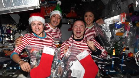 (From left) Mir, Pirmitano, Morgan and Koch celebrate Christmas in space - in matching pajamas.