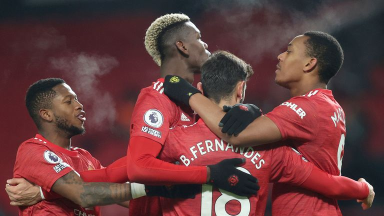 Manchester United Bruno Fernandez (18), celebrates with his team-mates after scoring his second goal in the match from the penalty spot during the Premier League football match between Manchester United and Aston Villa at Old Trafford in Manchester, England, Friday January 1, 2021