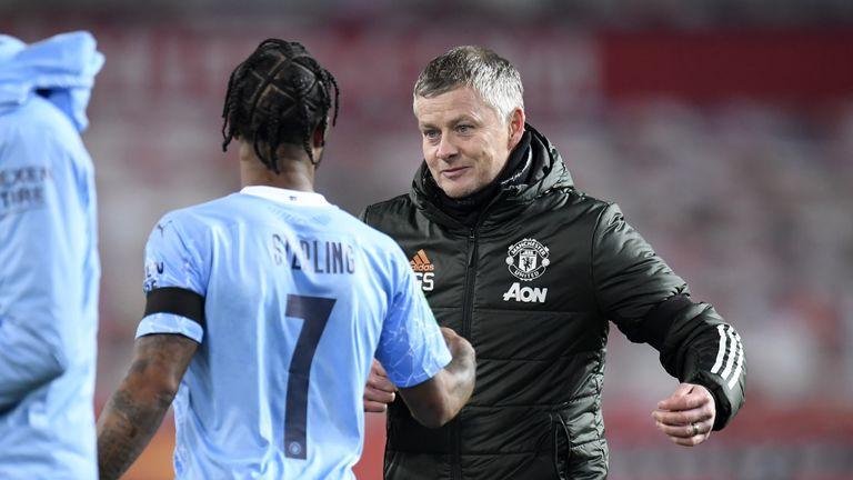 Raheem Sterling and Manchester United manager Ole Gunnar Solskjaer shake hands.