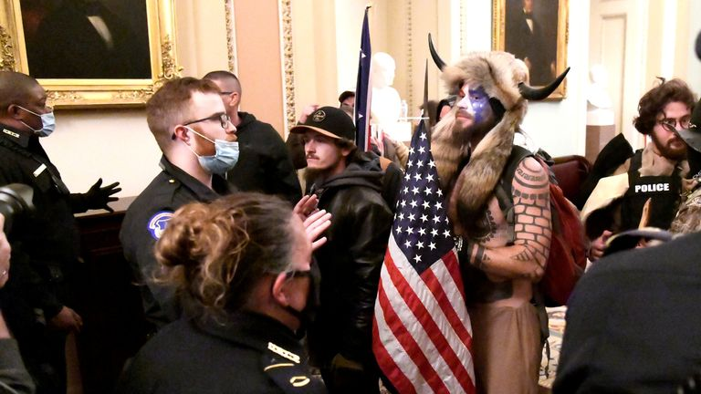 Police face supporters of President Donald Trump inside the Capitol