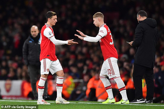 Smith Roe eased the pressure on Arsenal after they overlooked Mesut Ozil (left).