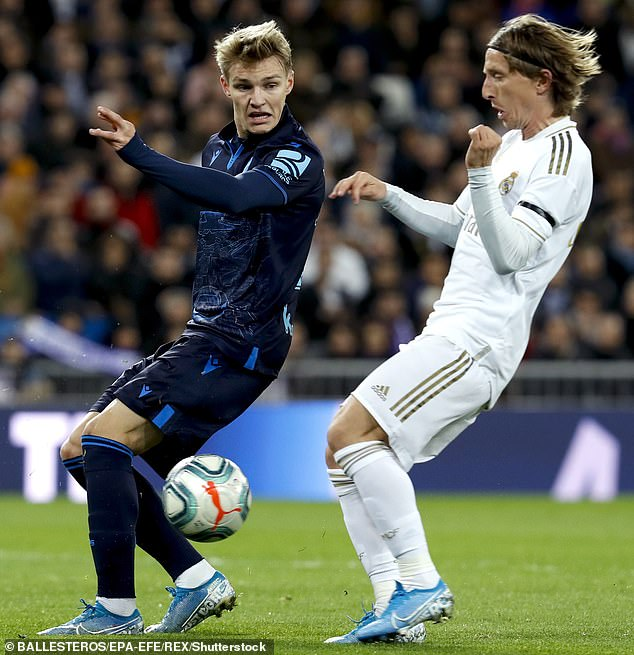 Real Madrid star Luka Modric challenges Odegaard while playing for Real Sociedad