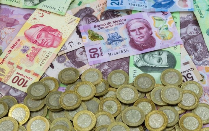 The peso is marginally lower due to the dollar's strength in a volatile session
