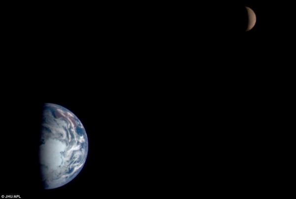 Half moon and just over half of the Earth on a black background.