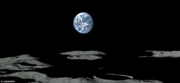 The surface of the moon is riddled with craters, and most of the blue and white Earth has been seen hanging in the black sky above it.