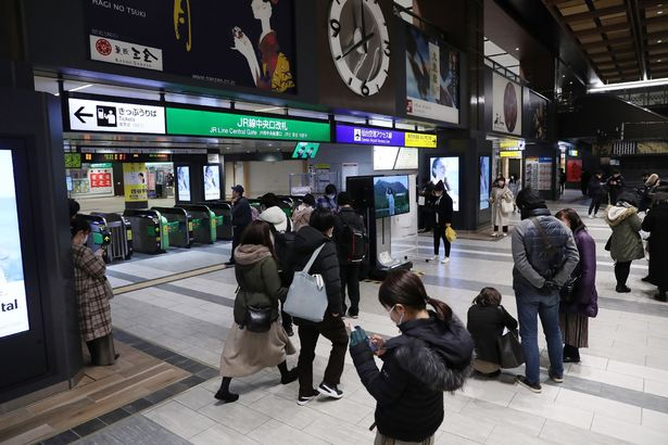 People stand in front of the ticket gates at JR Sendai station in Sendai