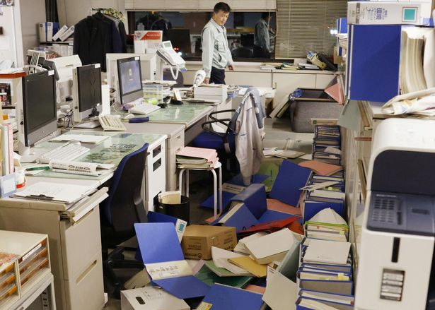 File folders and other items were seen strewn on the floor of Hirono's town office after a strong earthquake