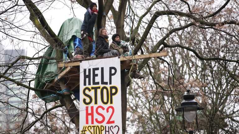 Insurgent HS2 protesters in a tree, part of a camp in Euston Square Gardens in central London, where protesters built a 100-foot tunnel network they were ready to occupy, after claiming the park was at risk from developing the HS2 line.  Picture date: Wednesday, January 27, 2021.