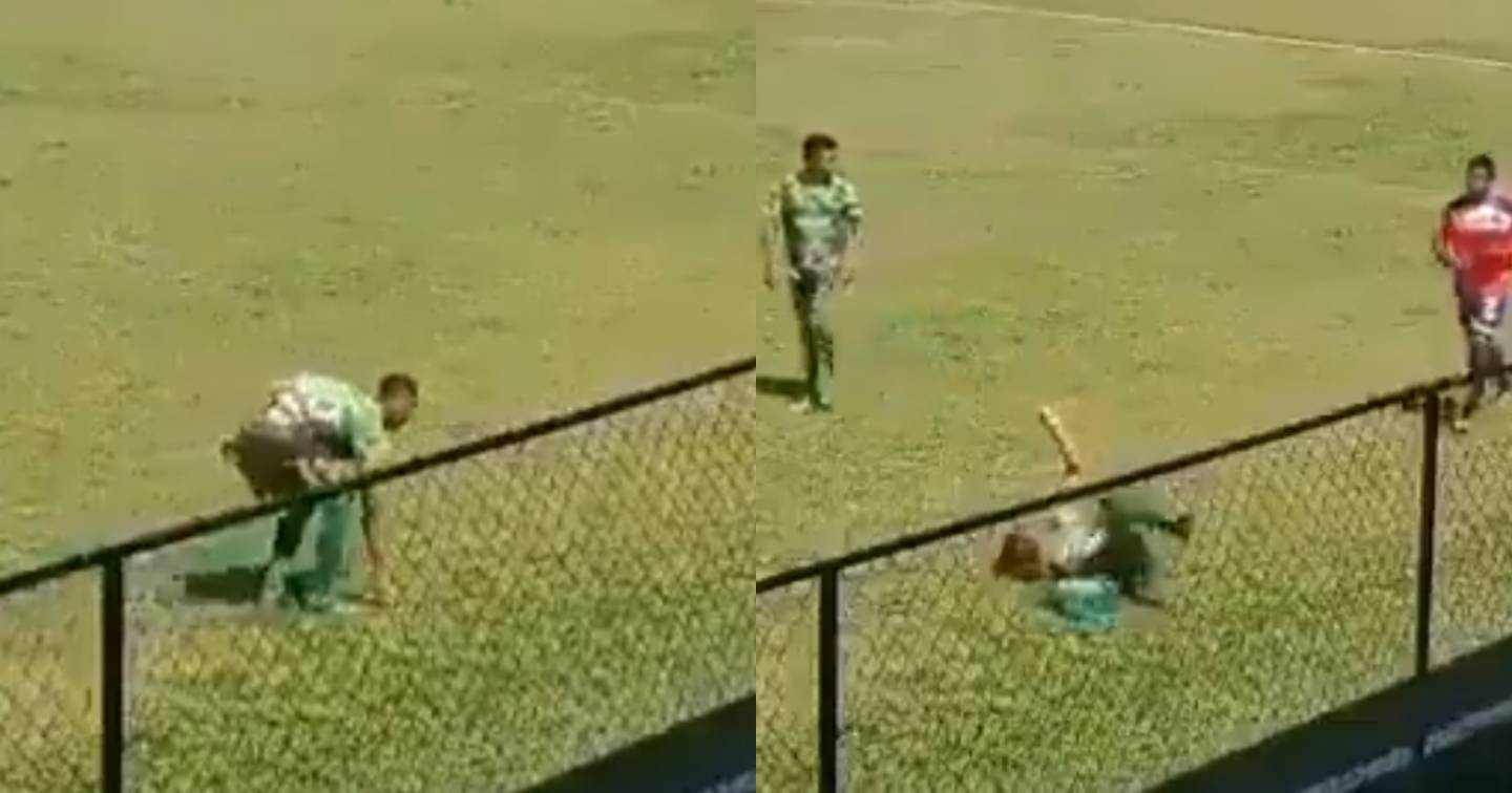 The soccer player pretended to receive a stone to deceive the referee