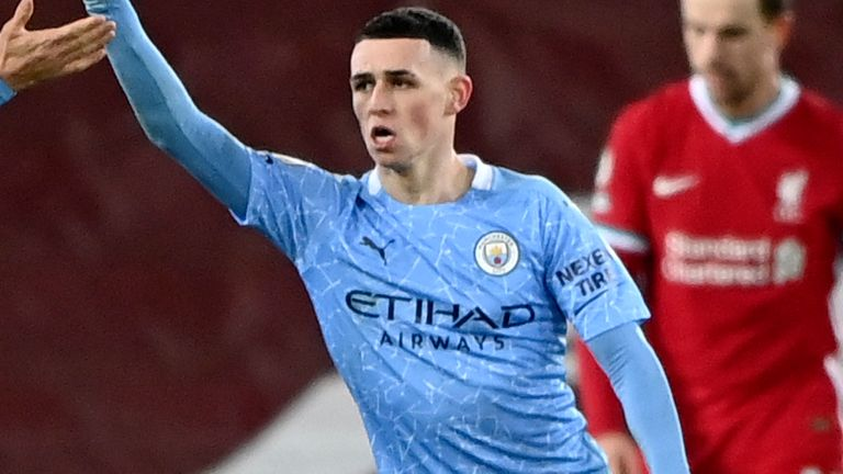 Phil Foden celebrates a goal against Liverpool