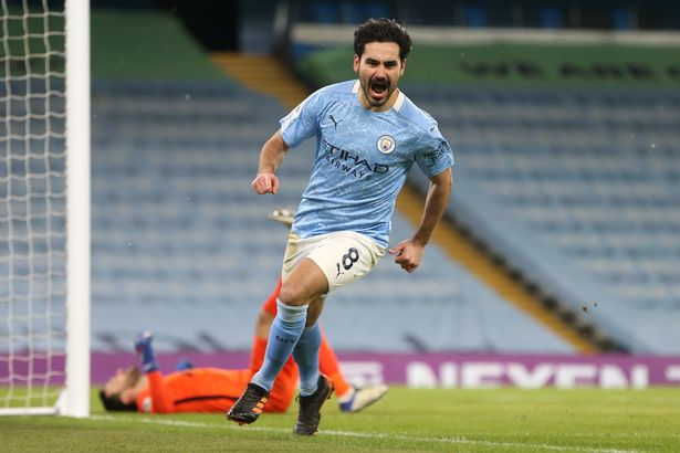 Manchester, England - February 13: Manchester City's Ilkay Gundogan celebrated after scoring the second goal for his team during the Premier League match between Manchester City and Tottenham Hotspur at Etihad Stadium on February 13, 2021 in Manchester, England.  Sports stadiums across the UK are still being severely restricted due to the coronavirus pandemic, with government social distancing laws banning fans inside stadiums, leading to matches being played behind closed doors.  (Photo by Victoria Hayden / Manchester City FC via Getty Images)