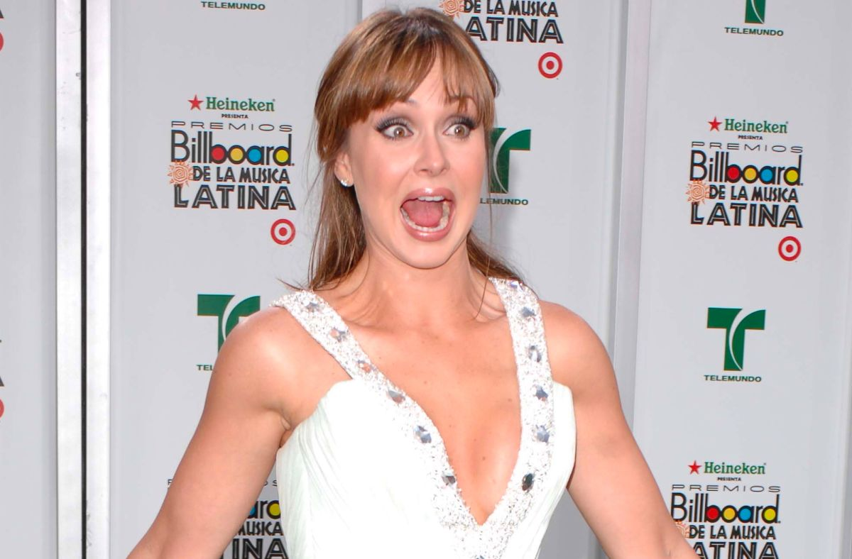 Gaby Spanic causes quite a sensory dance on the beach, wearing a black bikini mini