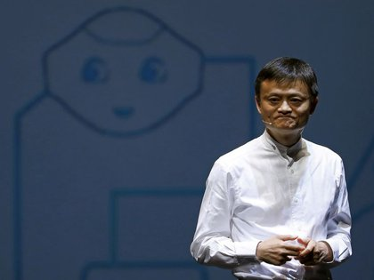 Jack Ma, founder and CEO of China's Alibaba Group, speaks in front of a photo of the eponymous SoftBank robot