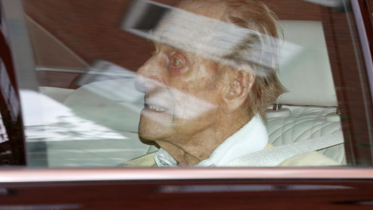 British CREDIT AP Prince Philip leaves King Edward VII Hospital in the back of a car in London, Tuesday, March 16, 2021. Queen Elizabeth II's 99-year-old husband has been hospitalized after undergoing a heart operation.  (AP Photo / Alastair Grant)