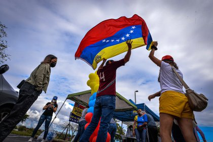 Venezuelan citizens celebrate DPS announcement at Doral Central Park in Doral, Miami-Tate, Florida