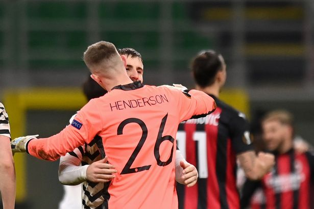 Henderson celebrates United's victory with Luke Shaw