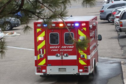 An ambulance leaves King Supers in Boulder, Colorado.  Photo: REUTERS / Kevin Mohd