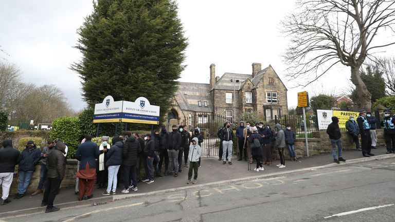 Protesters gathered outside the Battle Grammar School in Batley, West Yorkshire, where a teacher was arrested for showing students a caricature of the Prophet Muhammad during a religious studies class.  Picture date: Friday, March 26, 2021.