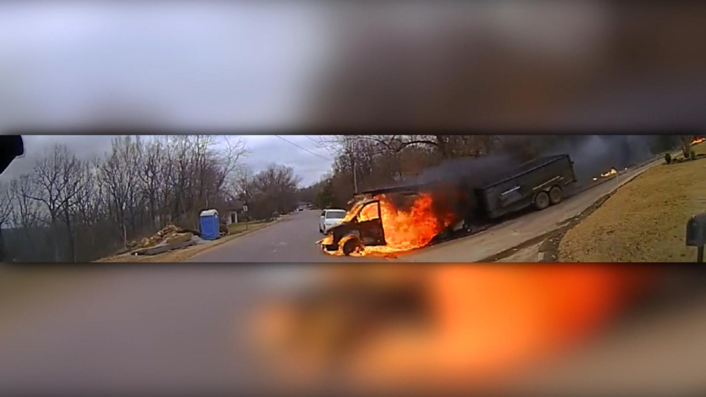 Watch the police act in front of a burning truck