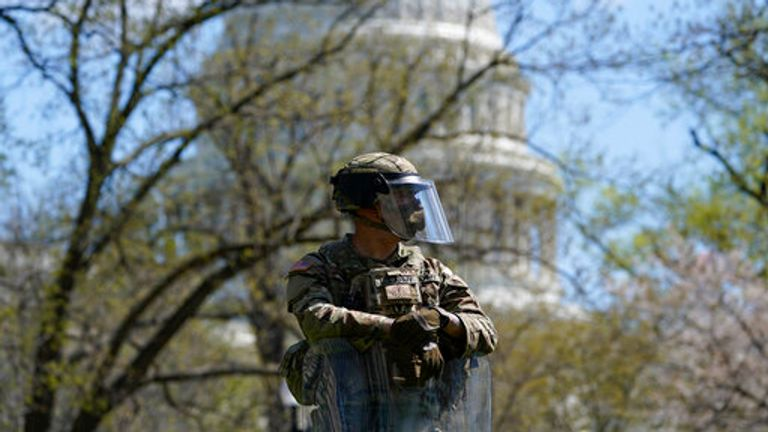 A soldier stands guard near the scene.  Pic: AP