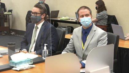 With his lawyer Derek Suev