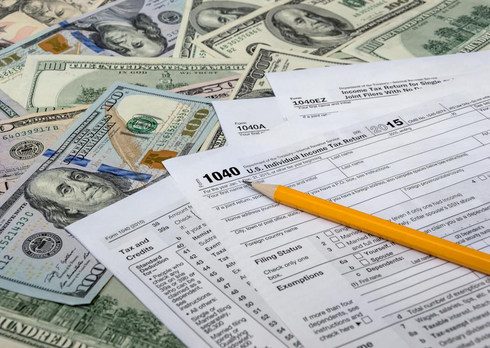 Billionaires, with a tax team at their command, always find a way to pay the least amount of tax possible.  Pictured is a US tax return form.  Photo: Getty Images.
