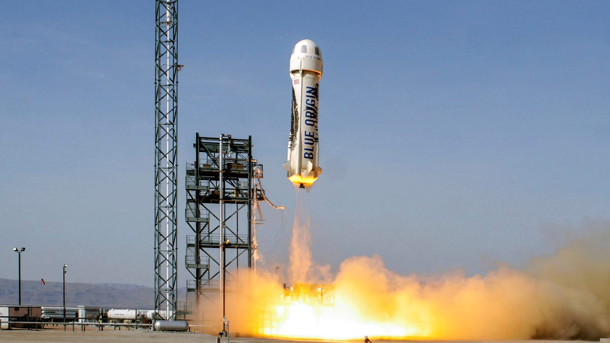 Jeff Bezos flies into space in the first manned launch of Blue Origin