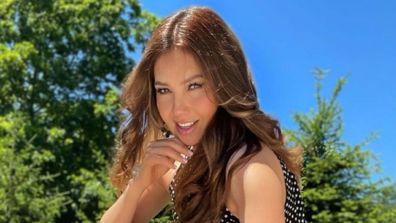 From the sand: Thalia raises the heat with her beauty