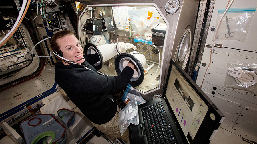 US astronaut Kate Robbins conducts an experiment aboard the International Space Station