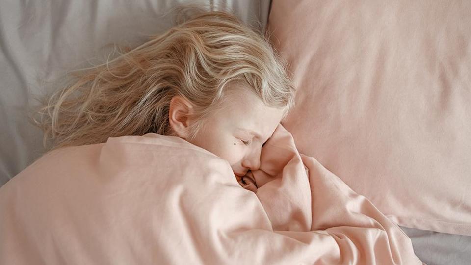 girl sleeping face suffering