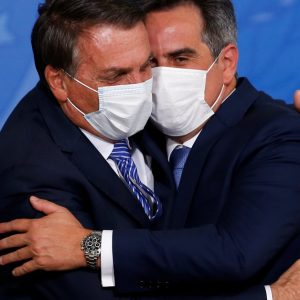 Bolsonaro closed an alliance with the bloc that dominates Brazil's parliament while the Supreme Court ordered an investigation