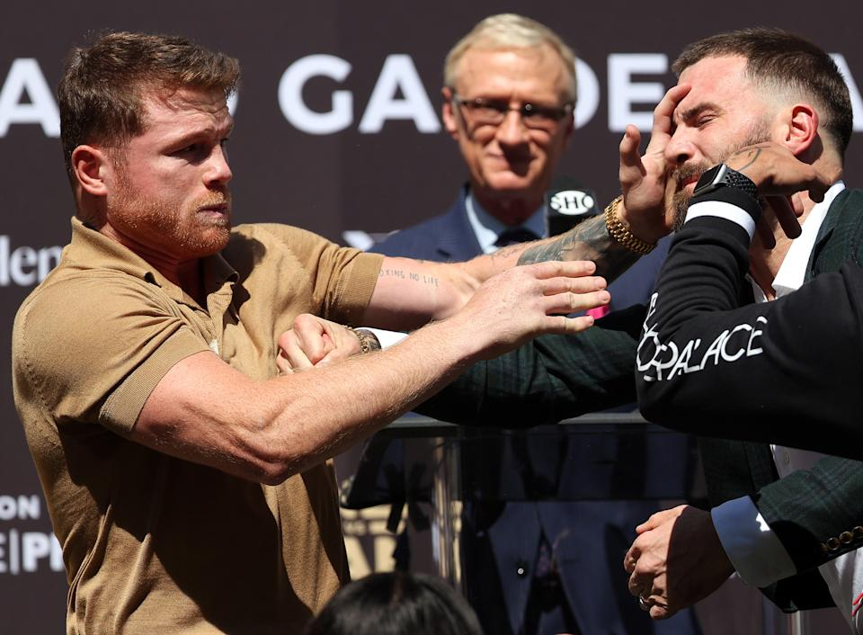 Beverly Hills, California - September 21: (LR) Keno Alvarez slams the Caleb plant during a press conference on September 21, 2021 in Beverly Hilton, California, ahead of their super middleweight fight at Beverly Hilton.  (Photo by Ronald Martinez / Getty Images)
