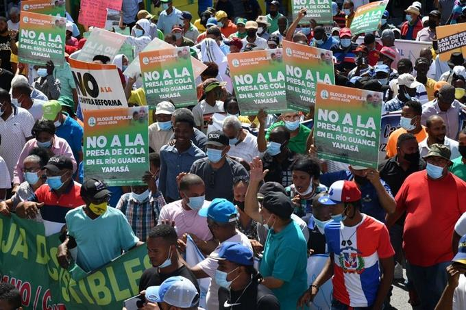 Social and environmental groups march against the exploitation of natural resources