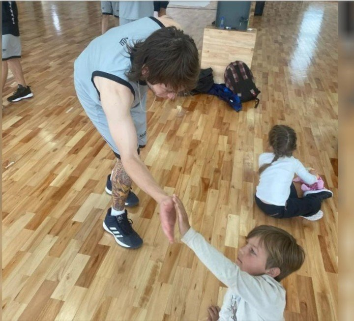 Paolo Londra plays with children on the Magnano Campus.  Tweet embed